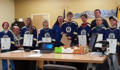 Glacier King Pee Wee C Hockey Team posing with Mayoral Recognition plaques
